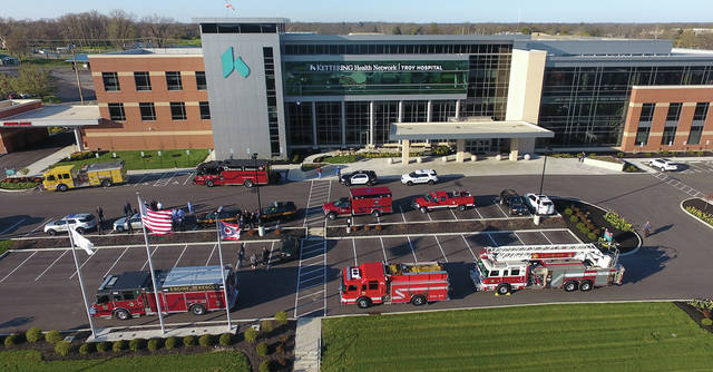 First responders from around the area gather at Kettering Health Network's Troy Hospital on Tuesday evening to recognize those who are on the lines with a Healthcare Workers Appreciation Night. Representatives from Troy and Piqua police departments, Miami County Sheriff's Office, Ohio State Highway Patrol, along with Troy, West Milton, Tipp City, Bradford, Anna and Covington fire departments joined forces in the Troy Hospital parking lot to show their support.
