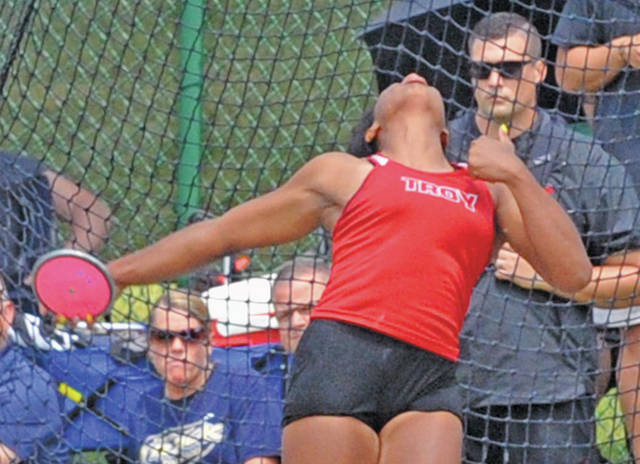 Josh Brown | Miami Valley Today file Troy throwing coach Aaron Gibbons watches Lenea Browder throw the discus and defend her state championship in the event at the 2019 Division I state track and field meet.
