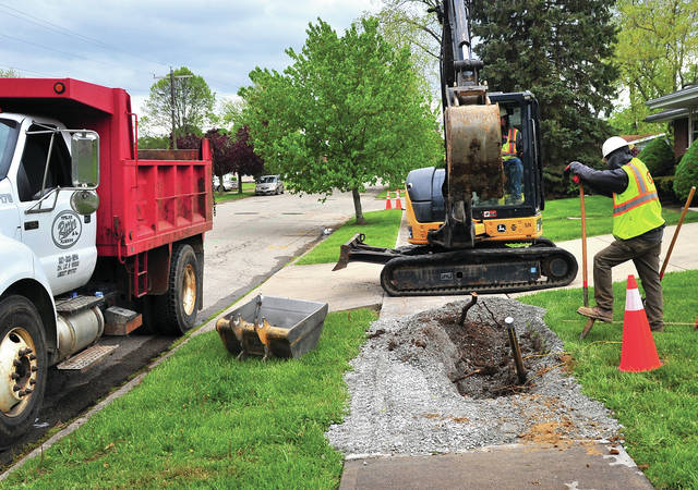 Ritter Plumbing & Pipeline Co. crews work in Westbrook on Monday as the project to upgrade natural gas lines for Vectren continues in Troy. Traffic is maintained in the Westbrook area but motorists are urged to slow down and use caution as Ritter Plumbing crews work throughout the subdivision.