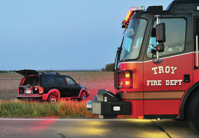 Troy firefighters work the scene of a single-vehicle rollover crash in the 2000 block of Washington Road on Tuesday evening. The driver was not seriously injured. Authorities believe that alcohol may have been a contributing factor in the crash. Miami Co. Sheriff's Deputies are investigating.