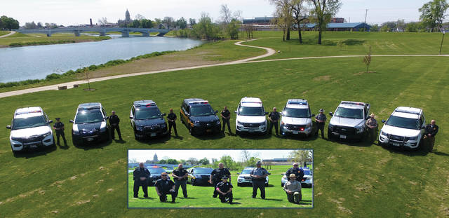 Miami County Law Enforcement agencies gathered to remember National Police Week with a group photo at Treasure Island in Troy on Wednesday. Participating agencies include Tipp City Police, West Milton Police, Piqua Police, Miami County Sheriff's Office, Troy Police, Ohio State Highway Patrol, Miami County Park District, and Covington Police. Due to both construction at the Courthouse Plaza and the current COVID-19 situation, there will be no formal memorial ceremony for a Law Enforcement Memorial Service, however Miami County's Law Enforcement agencies still pay tribute to local officers who have given their lives in the line of duty. Lest we forget.