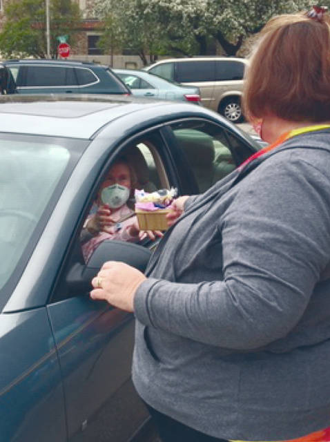 Provided photo Ohio's Hospice of Miami County staff showeed its volunteers their appreciation with a drive-through thank-you event to acknowledge and thank them. Fifty-five volunteers drove up to the parking lot at Ohio's Hospice of Miami County and was given a basket of treats.