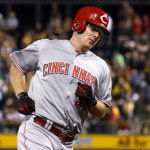 Rookie Smith shaky in debut, Reds fall to Pirates 7-6