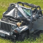 Jeep flips on I-71, injures driver