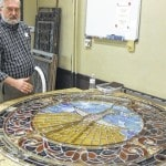 Historic church window made whole by stained glass artist