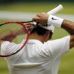 The Latest: Federer loses to Raonic in Wimbledon semifinals