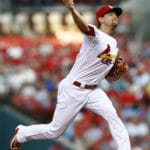 Holt sparks 8th inning rally as Reds beat Cardinals