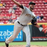 Votto homers, Barnhart plates 4 in Reds 7-4 win over Pirates