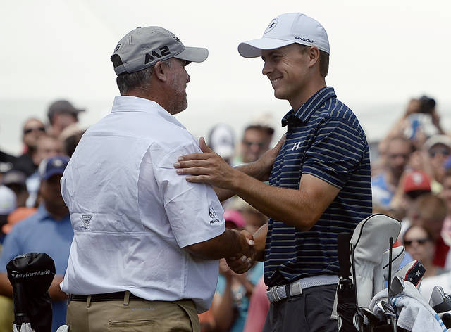 Jordan Spieth, right, greets Boo Weekley, left, on the first tee during the final round of the Travelers Championship golf tournament, Sunday, June 25, 2017, in Cromwell, Conn. (AP Photo/Jessica Hill)