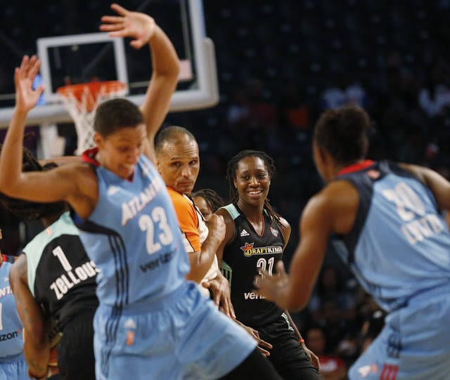 In this Sunday, July 2, 2017, photo, New York Liberty forward Tina Charles smirks at contact between two players during the Liberty's 81-72 loss to the Atlanta Dream in McCamish Pavilion, in Atlanta. Post players are scoring at historic pace in the WNBA. The top three scorers in the league all operate on the low block: Phoenix's Brittney Griner, Sylvia Fowles in Minnesota and New York's Tina Charles. Never in the history of the league has three post players led the WNBA in scoring. (AP Photo/Andy Buhler)