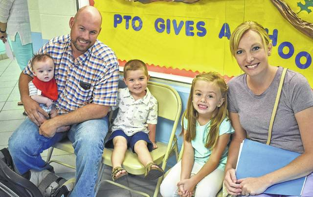 Mom Tara, far right, Dad Isaac and even little Hunter Barr are there when M.J. and Chloe go to their first day of school at Putman Elementary in Blanchester. M.J. is starting preschool, while Chloe goes into her first day of kindergarten.