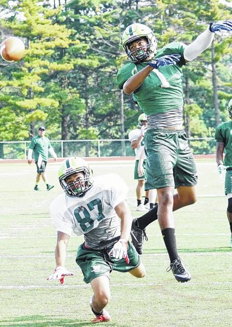Wilmington College freshman wide receiver Joel Armistad (87) and junior defensive back Jay Higgins (1) during passing drills at Townsend Field.