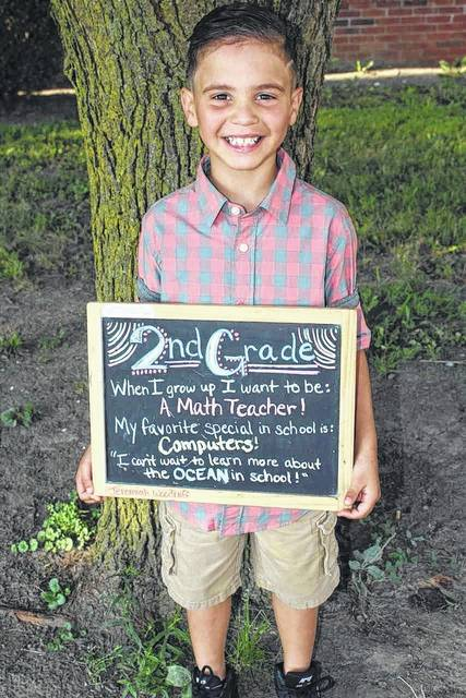Jeremiah Woodruff on his first day of second grade at Denver Place Elementary .