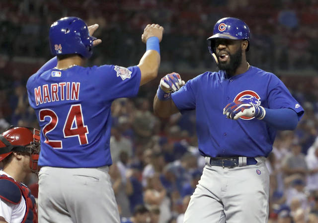 Chicago Cubs' Jason Heyward, right, is congratulated by teammate Leonys Martin after hitting a three-run home run during the eighth inning of a baseball game against the St. Louis Cardinals on Tuesday, Sept. 26, 2017, in St. Louis. (AP Photo/Jeff Roberson)