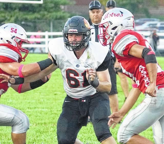 Wilmington's Jaren Evans (61) faced his former teammates at East Clinton Friday and was among the tackle leaders for the Hurricane.