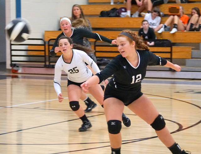Front to back, Wilmington's Sydney Wright, Alix South and Madi Flint against Batavia Thursday night.
