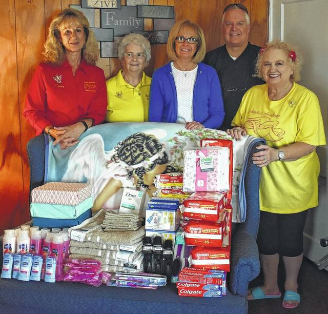 From left are Cindy Secret, Sandy McKinney, Connie Adams, Matt Moore and Joann Leach standing with the donations made by Adams and Moore on behalf of the Modern Woodmen, a non-profit organization. The donations include six of each item, including diapers, wipes, and toiletries. The items will be given to the six ladies living at Angel House which serves as a shelter for single, pregnant, homeless women.