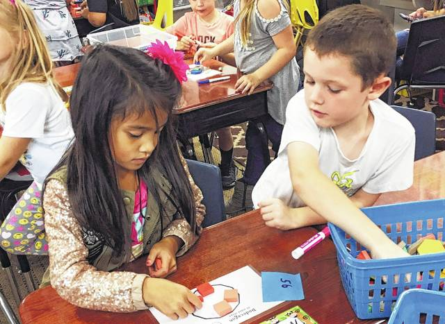 Students at Clinton-Massie Elementary School try out new games and have fun while learning math.