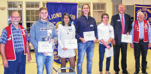From left are Lions Club President Lion John Beireis, Wilmington College students Thomas Sousa (Brazil), Ipsy Castillo (Costa Rica) and Eric lundquist (Sweden) . Clinton-Massie student Pablo Hess Munoz (Spain), Wilmington College Public Relations Director, Randy Sarvis and Past Lions Club President and current member Gene Snyder.