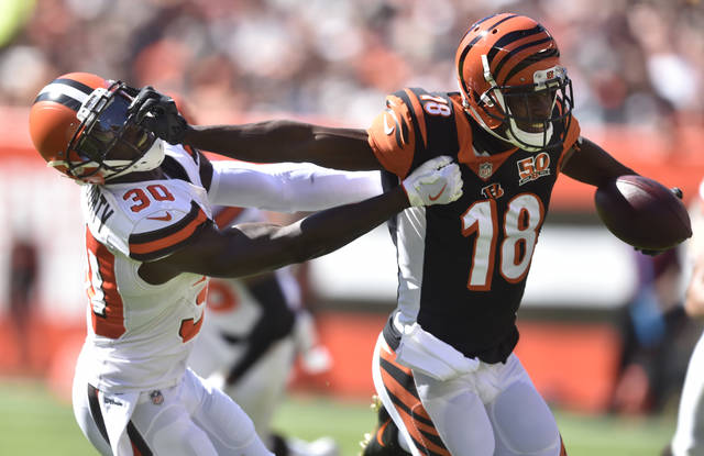 Cincinnati Bengals wide receiver A.J. Green (18) blocks Cleveland Browns defensive back Jason McCourty (30) in the first half of an NFL football game, Sunday, Oct. 1, 2017, in Cleveland. (AP Photo/David Richard)