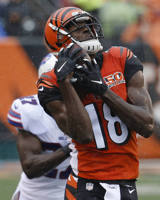 Cincinnati Bengals wide receiver A.J. Green catches a pass before running in for a touchdown during the first half of an NFL football game against the Buffalo Bills, Sunday, Oct. 8, 2017, in Cincinnati. (AP Photo/Frank Victores)