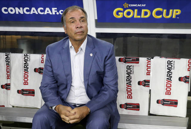 "FILE - In this July 22, 2017, file photo, United States head coach Bruce Arena sits on the bench prior to a CONCACAF Gold Cup semifinal soccer match against Costa Rica, in Arlington, Texas. Arena has resigned in the wake of the teams U.S. national team's crash out of contention for the 2018 World Cup. ""We didn't get the job done, and I accept responsibility,"" Arena said in a statement on Friday, Oct. 13, 2017.(AP Photo/LM Otero, File)"