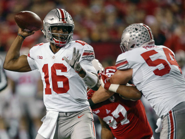 Ohio State quarterback J.T. Barrett (16) throws as offensive lineman Billy Price (54) blocks Nebraska defensive lineman Deontre Thomas (97) during the first half of an NCAA college football game in Lincoln, Neb., Saturday, Oct. 14, 2017. (AP Photo/Nati Harnik)