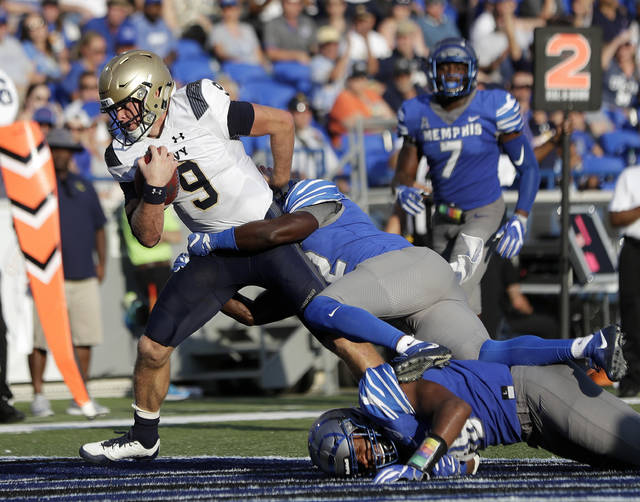 Navy quarterback Zach Abey (9) scores a touchdown on an 8-yard run against Memphis in the second half of an NCAA college football game Saturday, Oct. 14, 2017, in Memphis, Tenn. Memphis upset Navy 30-27. (AP Photo/Mark Humphrey)