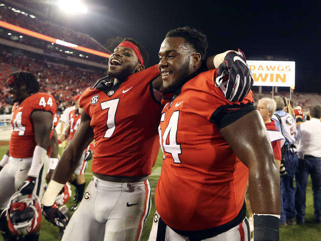 Georgia running back D'Andre Swift (7) and offensive lineman Justin Shaffer (54) leave the field after Georgia defeated Missouri 53-28 in an NCAA college football game Saturday, Oct. 14, 2017, in Athens, Ga. (AP Photo/John Bazemore)