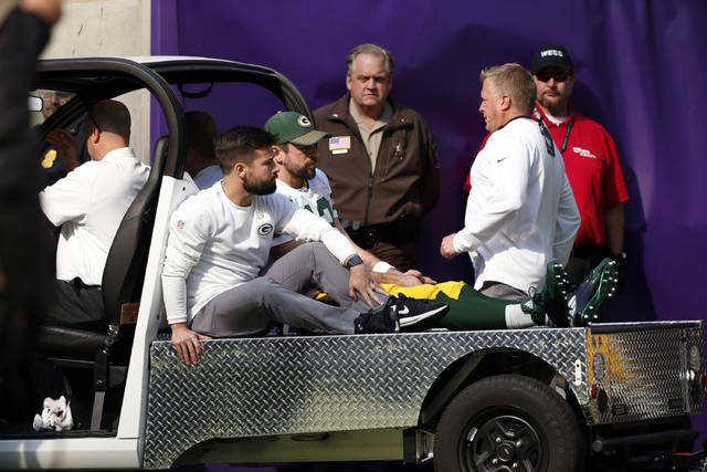 Green Bay Packers quarterback Aaron Rodgers (12) rides a cart to the locker room after being injured against the Minnesota Vikings in the first half of an NFL football game in Minneapolis, Sunday, Oct. 15, 2017. (AP Photo/Bruce Kluckhohn)