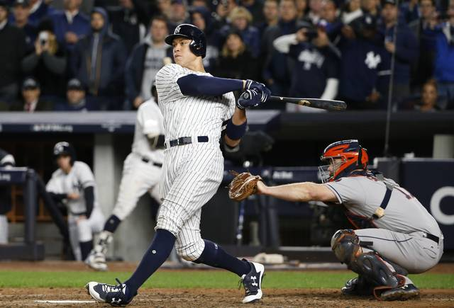 New York Yankees' Aaron Judge hits a three-run home run during the fourth inning of Game 3 of baseball's American League Championship Series against the Houston Astros Monday, Oct. 16, 2017, in New York. (AP Photo/Kathy Willens)
