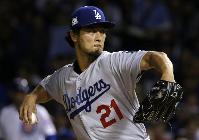 Los Angeles Dodgers starting pitcher Yu Darvish (21) throws during the first inning of Game 3 of baseball's National League Championship Series against the Chicago Cubs, Tuesday, Oct. 17, 2017, in Chicago. (AP Photo/Nam Y. Huh)