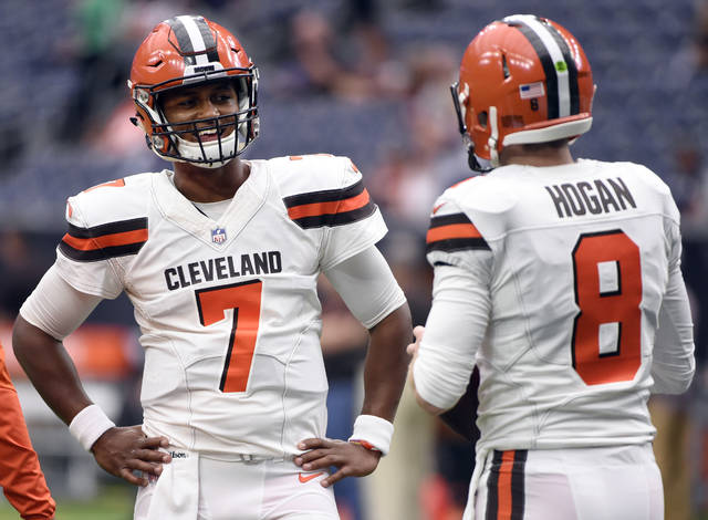 FILE - In this Sunday, Oct. 15, 2017, file photo, Cleveland Browns quarterback DeShone Kizer (7) talks with quarterback Kevin Hogan (8) during warm ups before an NFL football game against the Houston Texans on in Houston. The winless Browns have reinstated Kizer as their starting quarterback for this week's game against Tennessee. Kizer was benched last week in Houston as Hogan started, but threw three interceptions as the Browns dropped to 0-6.  (AP Photo/Eric Christian Smith, File)