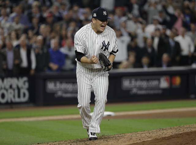 New York Yankees starting pitcher Masahiro Tanaka reacts after striking out Houston Astros' Josh Reddick during the fifth inning of Game 5 of baseball's American League Championship Series Wednesday, Oct. 18, 2017, in New York. (AP Photo/David J. Phillip)