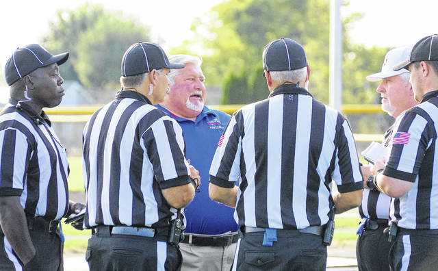 Clinton-Massie head coach Dan McSurley meets with officials prior to the first game of the season. McSurley and the Falcons will play at unbeaten Goshen Friday night with first place in the SBAAC American Division on the line.