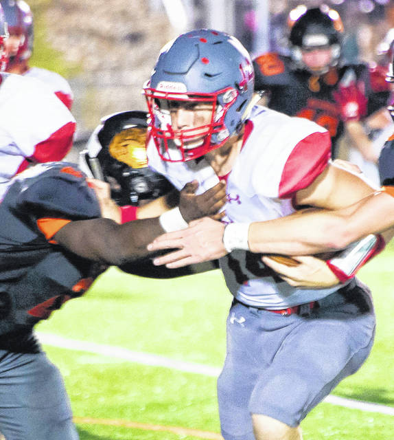 Wilmington's Frantz Cherisca (left) makes a tackle during a game earlier this season against Goshen.