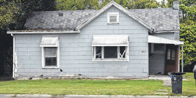 """The residence on Main Street that, according to its neighbors, has """"thousands upon thousands"""" of cockroaches."""