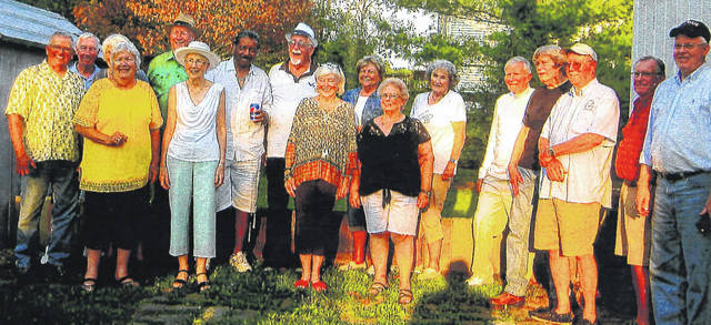 The Wilmington High School Class of 1960 held a 75th birthday party in September featuring a cookout for all class members at Ed Kienle's house. Attendees were, from left: Carl Grey, John Dehan, Sara Day Burnett, Carol Kohler Nichols, Russ Green, Norma Jean Webb Lind, Melvin Nance, David Bailey, Kathy Schalnat Kingston, Jane Ann Webb Spence, Rosemary Chandler, JoAnn Davis Murphy, John Workman, David Reisinger, Don Maher and Keith Gregory. Door prize winners were Russ Green, Melvin Nance and John Workman. Coming the longest distance was Keith Gregory, from San Diego, California.