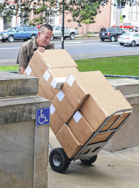 Boxes and boxes of ballots for the Nov. 7 general election were delivered Wednesday to the Clinton County Board of Elections at the county courthouse. Courthouse staff opened a front door for UPS employee Tom McFadden and his shipment of ballots printed for local citizens.