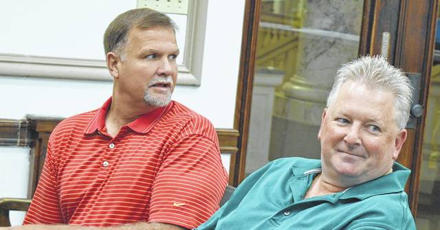 Prior to meeting with county commissioners Monday are, from left, Clinton County Auditor Terry Habermehl and Clinton County Treasurer Jason Walt. The two men, along with Clinton County Assistant Prosecuting Attorney Andrew McCoy, comprise the Clinton County Budget Commission.