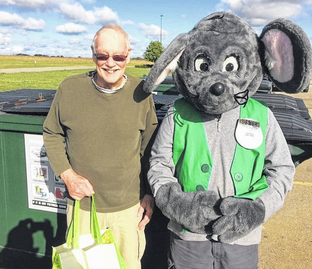 """Buster the Mouse from the Clinton County Solid Waste District has caught the second winner in the Get Caught Recycling Campaign. Harry Brumbaugh was caught """"green-handed"""" putting the proper recyclables into the community drop-off recycling containers located at Blanchester Kroger. This year's Get Caught Recycling theme is Rest & Relaxation. For his efforts in practicing the 3 R's, Harry received several recycled content prizes. Don't miss out on this chance to win great prizes by simply recycling household items such as bottles, jars, and newspapers. For a list of the local recycling drop-off locations and acceptable materials, visit the SWMD's website at www.co.clinton.oh.us/recycling. There are still two weeks left in the campaign, so be on the lookout — you could be the next person caught green-handed!"""