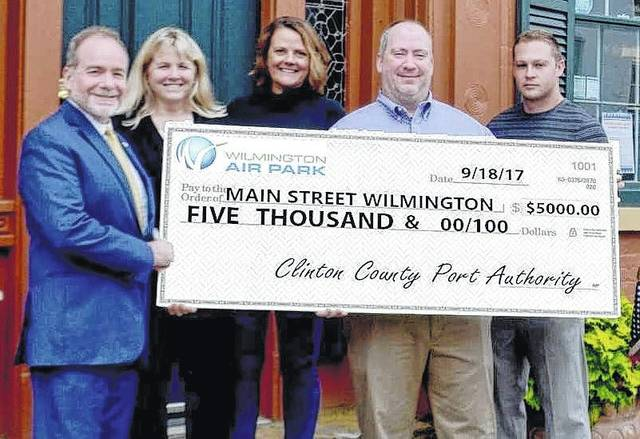 The $5,000 presented by the Clinton County Port Authority to Main Street Wilmington will help further the work of MSW.