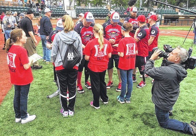 Members of the Clinton County Crush 14U girls softball team attended the Wounded Warrior Amputee Softball game in May 2016 and met members of the team afterward while they were being filmed for a documentary.