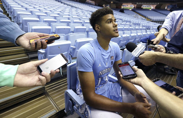 FILE - In this Oct. 17, 2017, file photo, North Carolina's Cameron Johnson speaks with reporters during the school's NCAA college basketball media day in Chapel Hill, N.C. A few of last year's Final Four teams have added transfers to help restock their rosters. Defending national champion North Carolina added a graduate transfer by signing Cameron Johnson from Pittsburgh. (AP Photo/Gerry Broome, File)