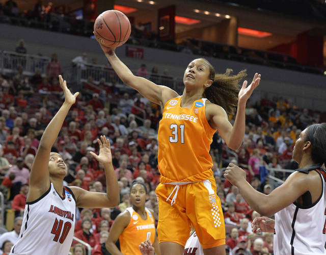 "FILE - In this March 20, 2017, file photo, Tennessee's Jaime Nared (31) grabs a rebound between Louisville's Ciera Johnson (40) and Myisha Hines-Allen (2) during an NCAA women's college basketball tournament game in Louisville, Ky. Nared was caught off guard this year when a teammate called her a ""mother figure,"" but that's a role she's filling as one of the lone seniors on a freshman-laden team. (AP Photo/Timothy D. Easley, File)"