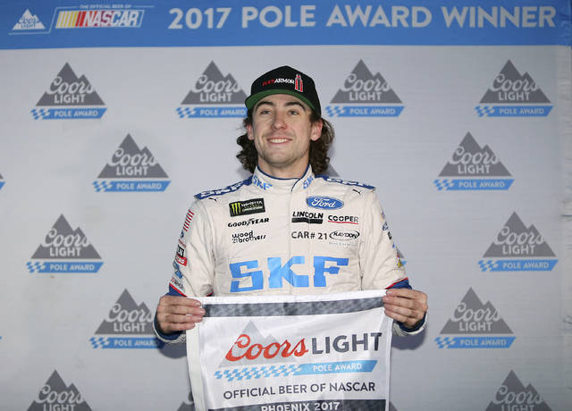 Ryan Blaney holds the pole award after winning the starting position for a NASCAR Cup Series auto race at Phoenix International Raceway, Friday, Nov. 10, 2017, in Avondale, Ariz. (AP Photo/Ralph Freso)