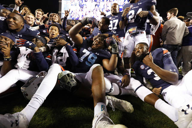 Auburn defensive lineman Andrew Williams (79) celebrates with the team after a 40-17 win over Georgia in an NCAA college football game on Saturday, Nov. 11, 2017, in Auburn, Ala. (AP Photo/Brynn Anderson)