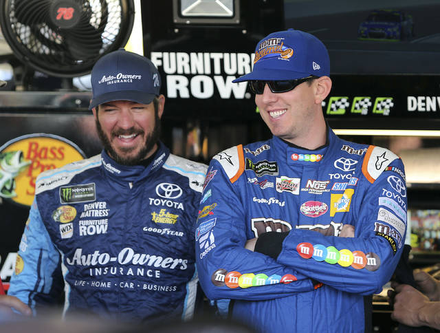 Kyle Busch, right, and Martin Truex Jr. laugh inside the garage area before practice for the NASCAR Cup Series auto race at Phoenix International Raceway, Friday, Nov. 10, 2017, in Avondale, Ariz. Both drivers have secured a spot in the Championship 4 heading into Sunday's race. (AP Photo/Ralph Freso)