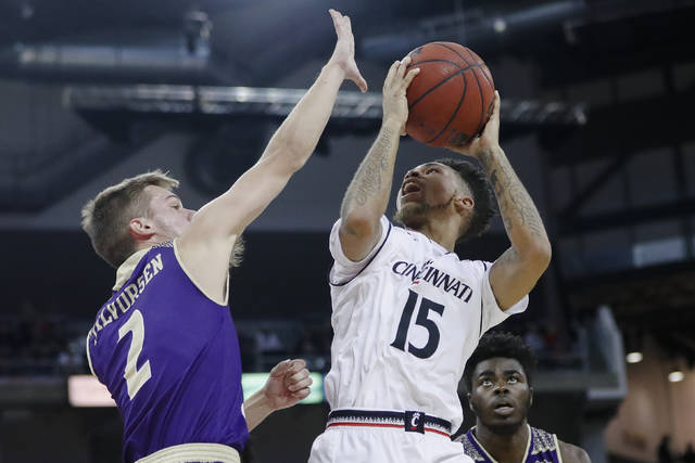Cincinnati guard Cane Broome (15) shoots against Western Carolina guard Matt Halvorsen (2) in the first half of an NCAA college basketball game, Monday, Nov. 13, 2017, at BB&T Arena in Newport, Ky. (AP Photo/John Minchillo)