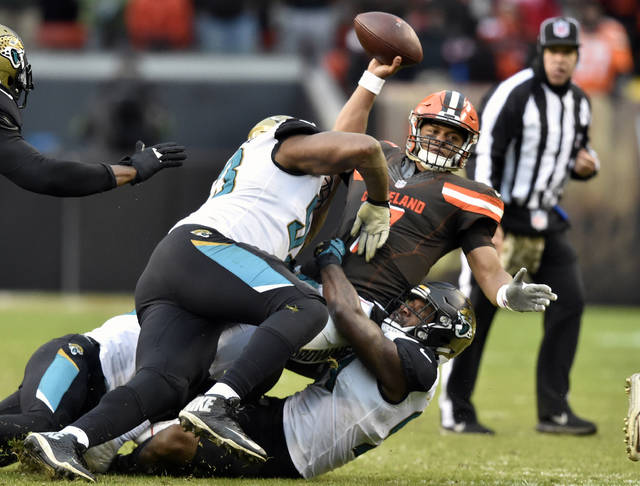 Cleveland Browns quarterback DeShone Kizer (7) is sacked in the second half of an NFL football game against the Jacksonville Jaguars, Sunday, Nov. 19, 2017, in Cleveland. (AP Photo/David Richard)